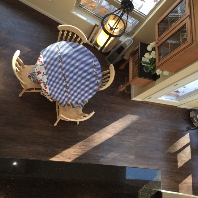 Aerial View of New Flooring and Stylish Table & Cabinetry
